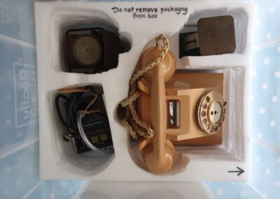 Communications (clockwise from left): WWII electric lamp, postal scales, rotary dial telephone, desktop microphone.