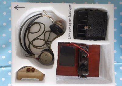 Communications (clockwise from left): Pair of headphones, box camera, working Morse code key, cat's eye road stud.