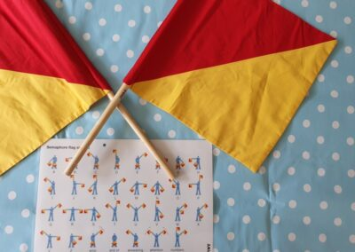 Communications: Four sets of mini semaphore flags and instructions are included in this loan box.